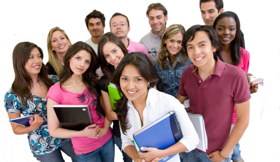 Happy group of students isolated over white
